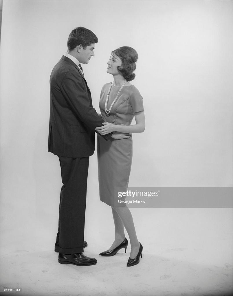 Couple embracing, studio shot : Stock Photo