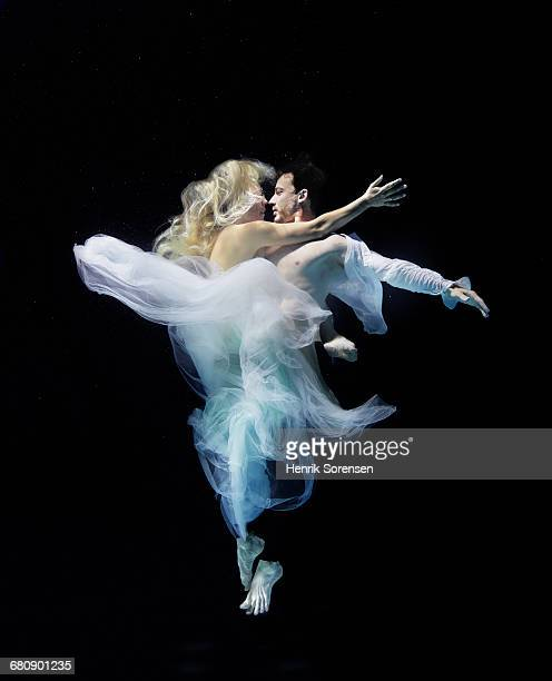 A couple embracing under water