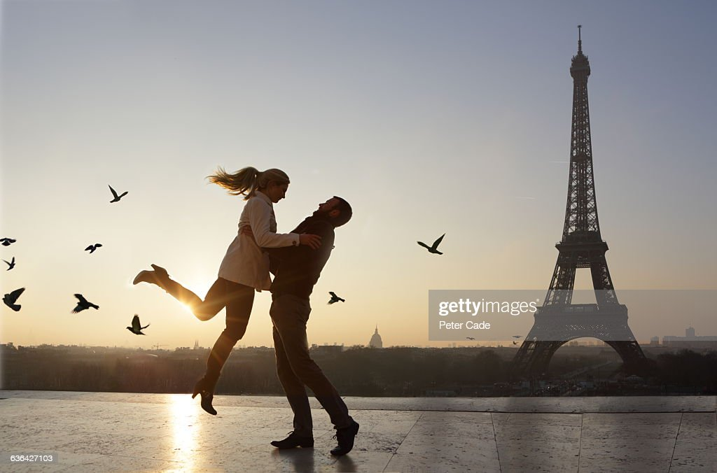 Couple embracing, view of Eiffel Tower : Stock Photo
