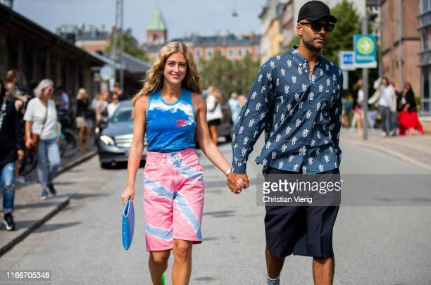 Couple Emili Sindlev and Mads Emil seen outside Holzweiler during Copenhagen Fashion Week Spring/Summer 2020 on August 07, 2019 in Copenhagen,...