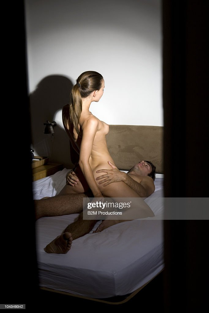 Couple Engaged In Sexual Intercourse On Bed Stock Photo -3344