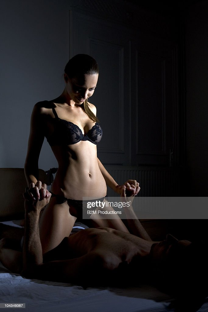 Couple Engaged In Sexual Intercourse On Bed Stock Photo -7087
