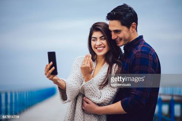 Couple engagement ring selfie