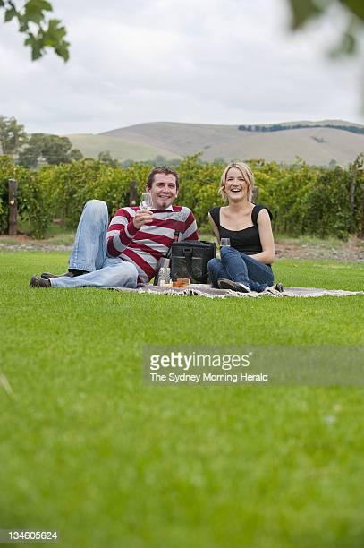 A couple enjoy a Butcher Baker winemaker hamper in the Barossa Valley South Australia