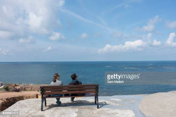 A couple enjoy coastal views in La Corbière on 2nd September 2017 in Jersey on the Channel Islands United Kingdom La Corbiere is situated at the...