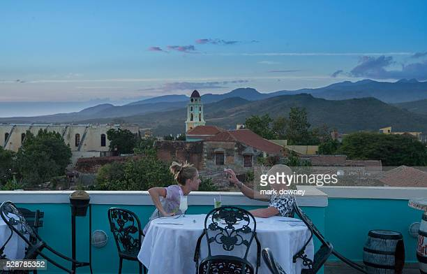Couple enjoy dinner with view Trinidad Cuba