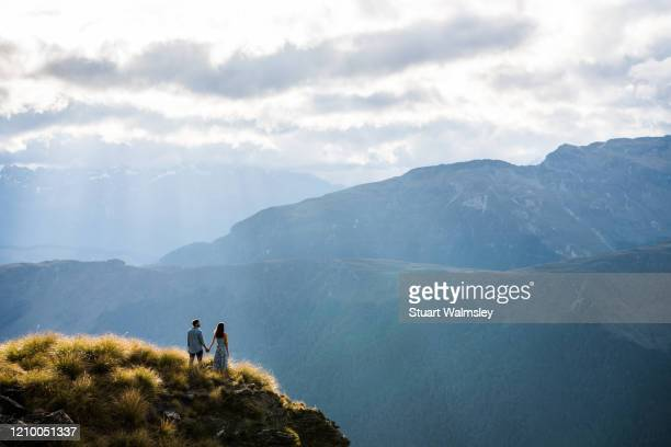 couple enjoy queenstown - otago stock pictures, royalty-free photos & images