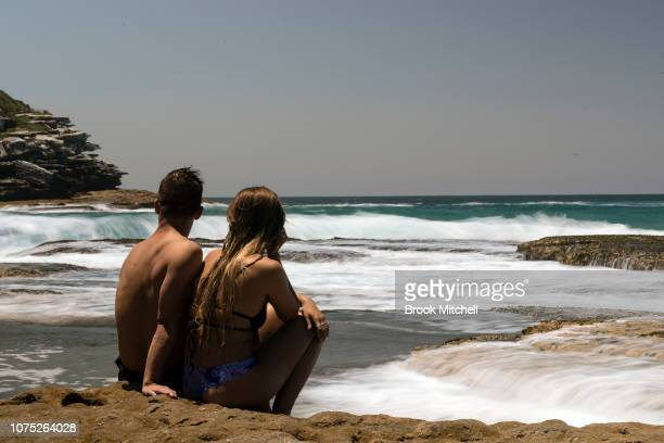 A couple enjoy the warm start to summer at Tamarama Sydney The city is set for a scorching start to Summer with temperatures expected to reach 35...