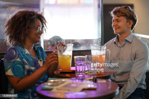 Couple enjoy their drinks in the Mile Castle pub on Freedom Day on July 19, 2021 in Newcastle upon Tyne, England. As of 12:01 on Monday, July 19,...