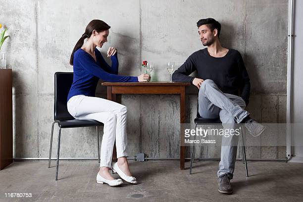 A couple enjoying a glass of wine in a restaurant