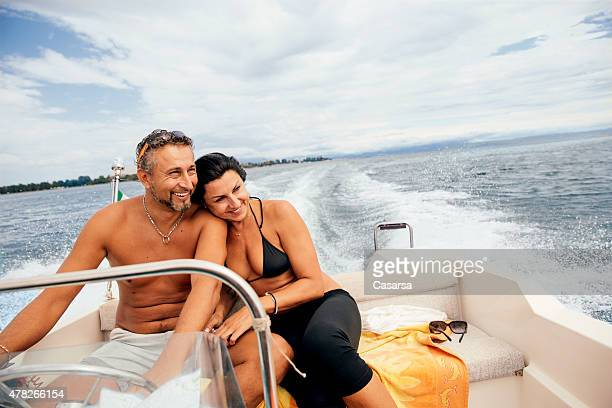 Couple enjoying a ride on a speedboat