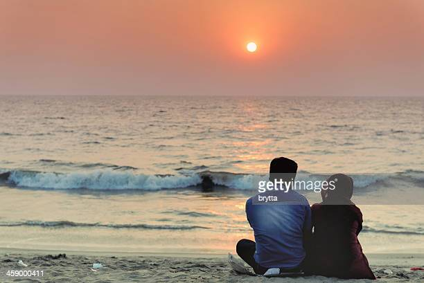 Couple enjoying a romantic sunset on the beach