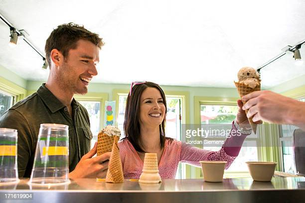 A couple enjoying a scoop of ice cream.