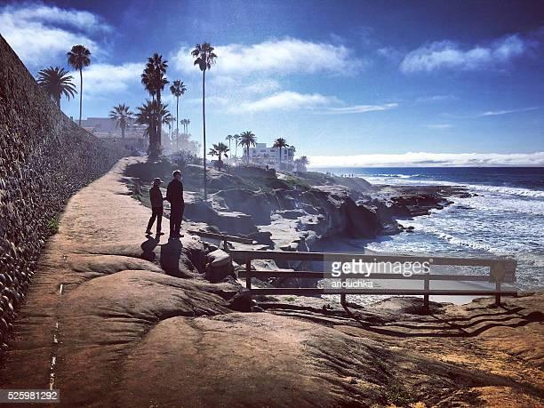 Couple enjoying a walk along La Jolla Beach, USA