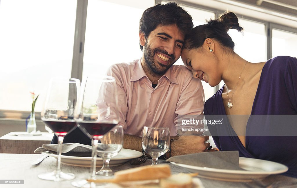 Couple enjoying and smiling at restaurant for St. Valentine : Stock Photo