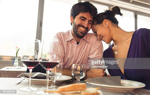 Couple enjoying and smiling at restaurant for St. Valentine