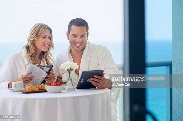 Couple enjoying breakfast on balcony