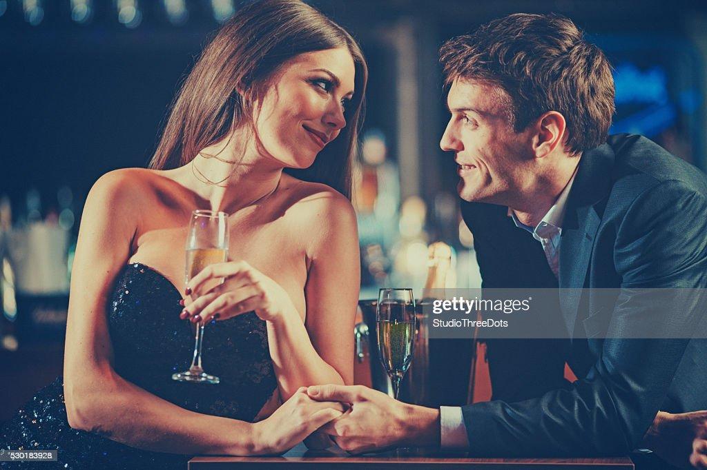 couple enjoying champagne : Stock Photo
