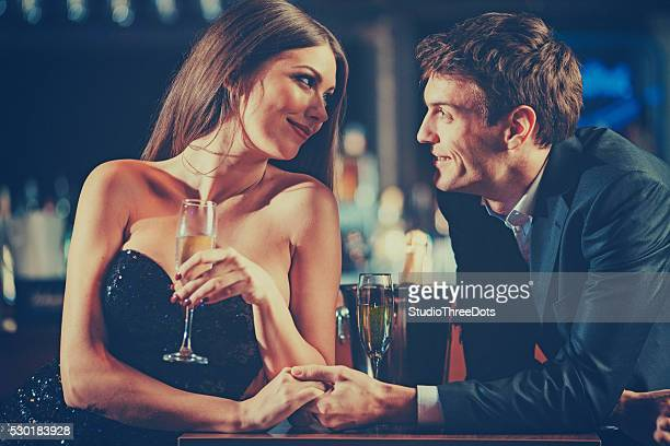 couple enjoying champagne - community engagement stock pictures, royalty-free photos & images