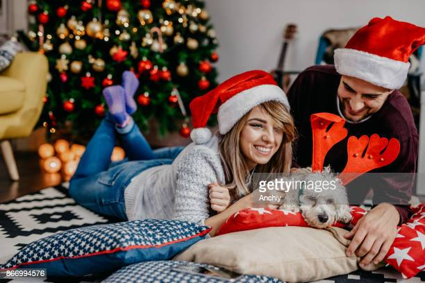 Couple enjoying christmas with their dog. New year's eve.