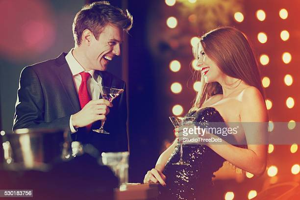 couple enjoying coctails in luxury bar