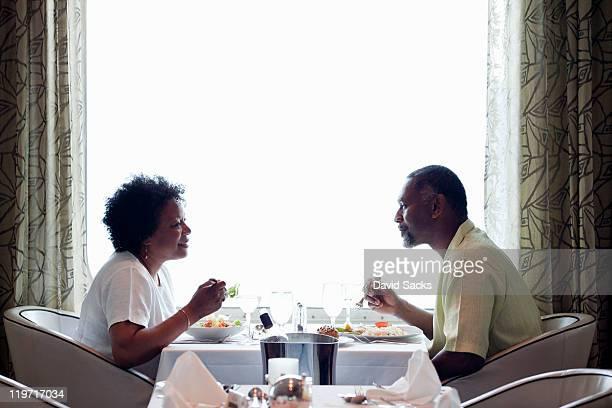 Couple enjoying dinner on cruise ship