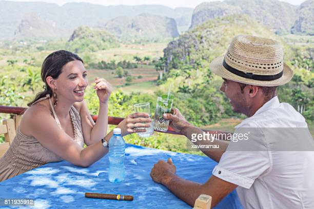 couple enjoying drinks against valle de vinales - valley stock pictures, royalty-free photos & images
