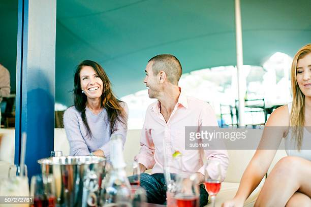 A couple enjoying each other at a restaurant