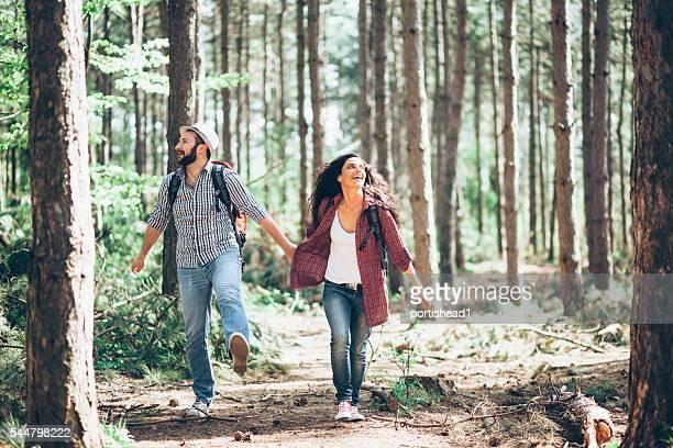 Couple enjoying forest hiking together