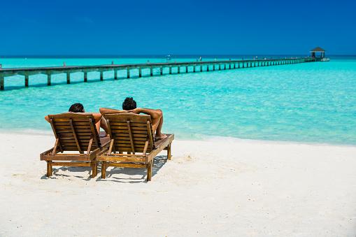 Couple enjoying holidays at Dhiffushi Holiday island, Maldives 879058726