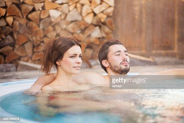 Couple enjoying in a hot tub