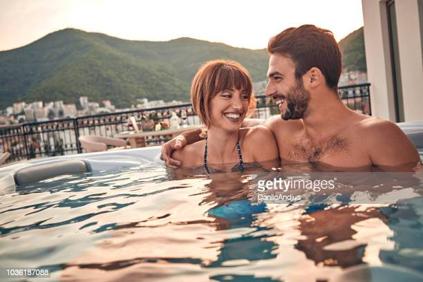 couple enjoying in hot tub - hot tub stock photos and pictures