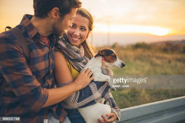 Couple enjoying in nature with dog