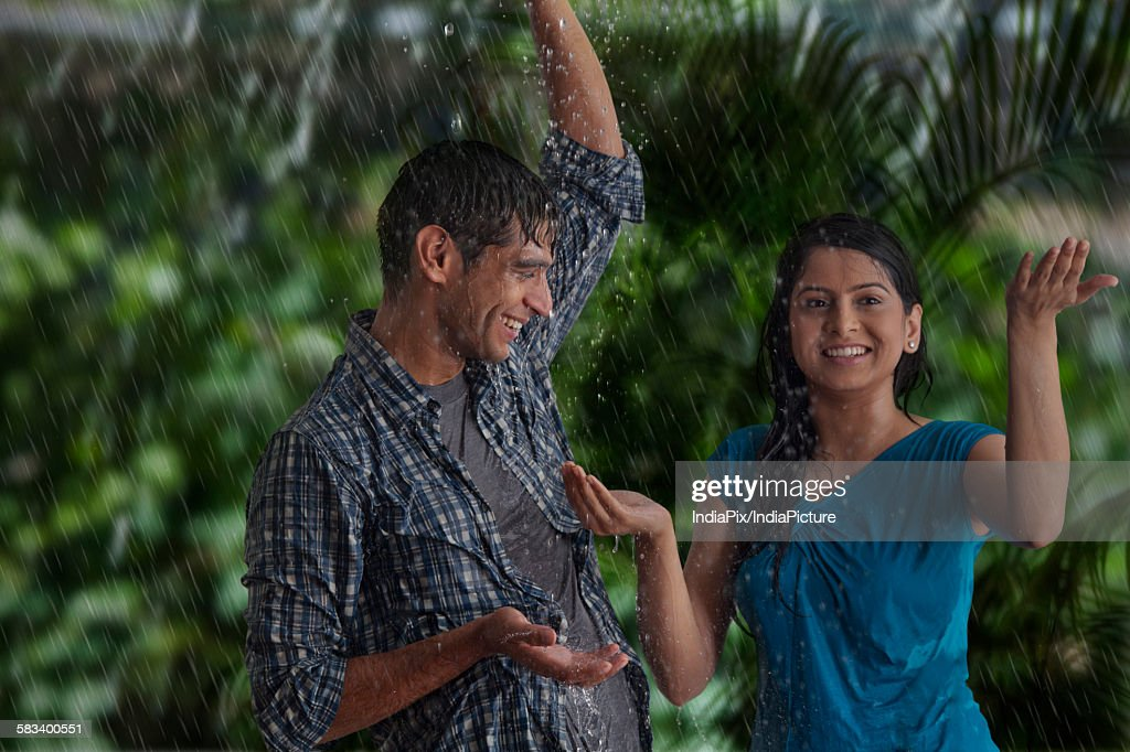 Couple enjoying in the rain : Stock Photo