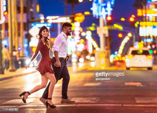 couple enjoying las  vegas nightlife - las vegas stock pictures, royalty-free photos & images