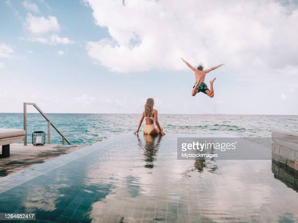 couple enjoying luxury vacations - tourist resort stock pictures, royalty-free photos & images