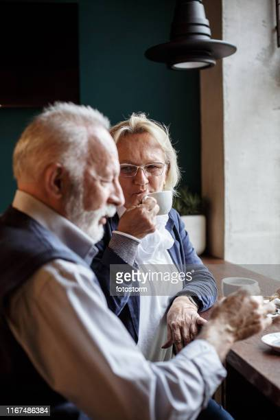 Couple enjoying morning coffee at the bar together