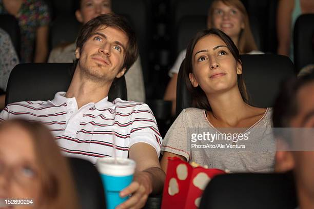 Couple enjoying movie in theater
