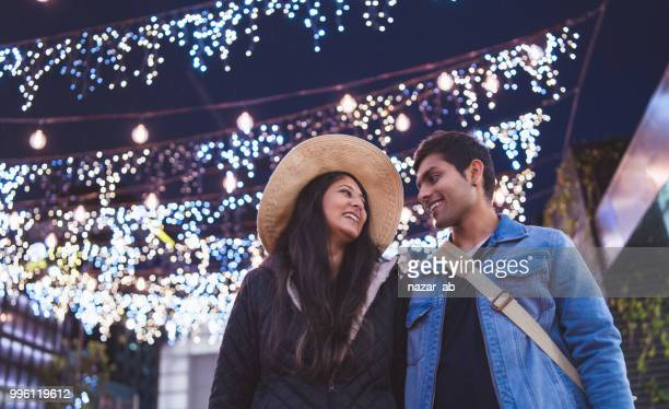 couple enjoying night life in city. - auckland stock pictures, royalty-free photos & images