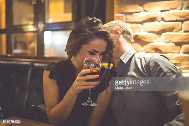 couple enjoying night out at cocktail bar - flirting stock pictures, royalty-free photos & images
