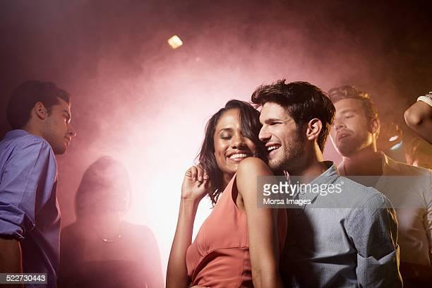 Couple enjoying on dance floor in nightclub