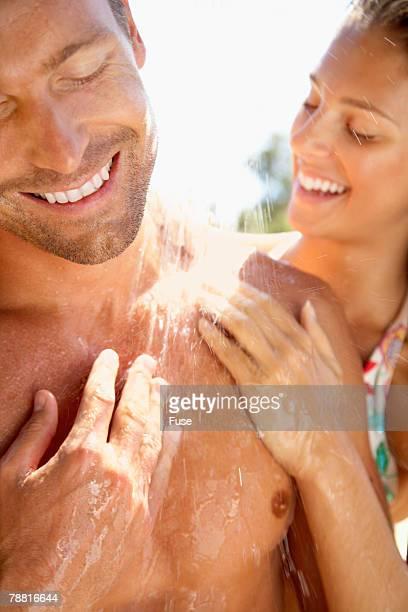 Couple Enjoying Outdoors Shower