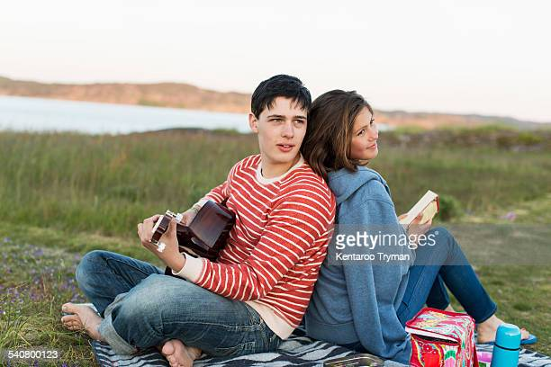 Couple enjoying picnic on field