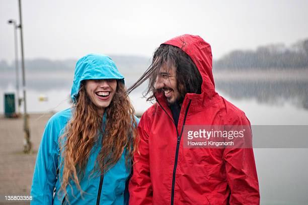 couple enjoying rainstorm