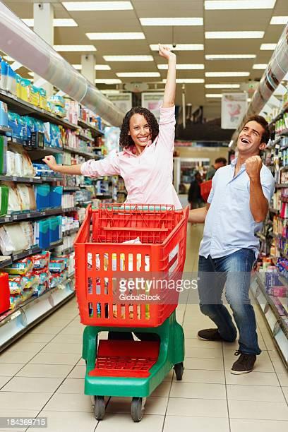 Couple enjoying shopping at super market