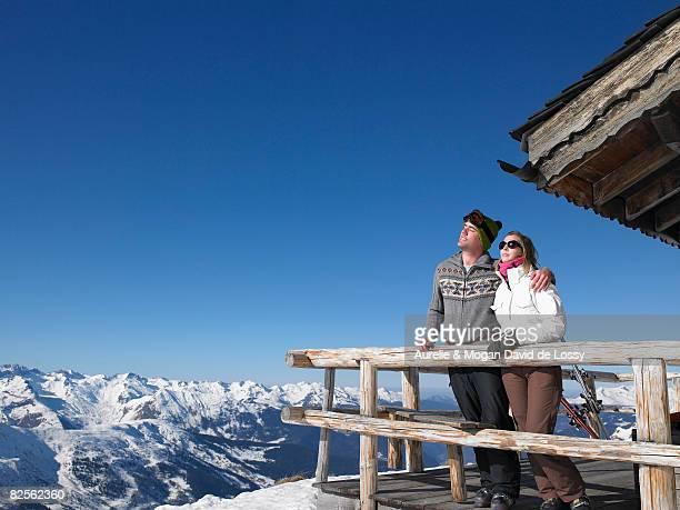 Couple enjoying sun at mountains
