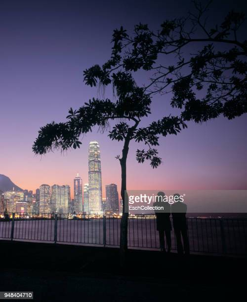Couple enjoying sunset at Victoria Harbour in Hong Kong