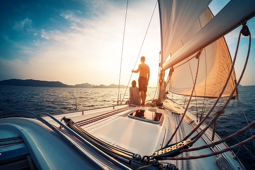 Couple enjoying sunset from the sail boat 643660216