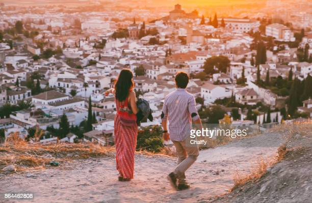 couple enjoying sunset in granada, spain - granada stock photos and pictures