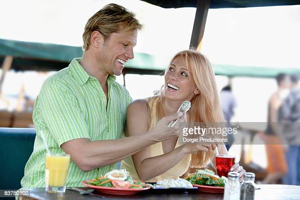 Couple enjoying Sushi together outdoors